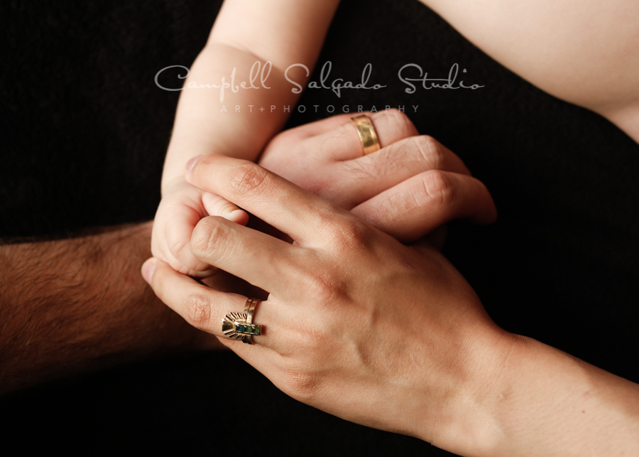 Portrait of family on black background by baby photographers at Campbell Salgado Studio in Portland, Oregon.