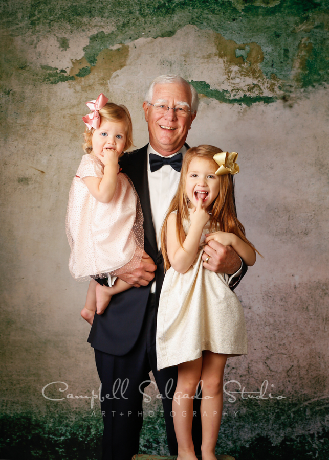 Multi generational portrait of grandfather and granddaughters on abandoned concrete background by family photographers at Campbell Salgado Studio in Portland, Oregon.