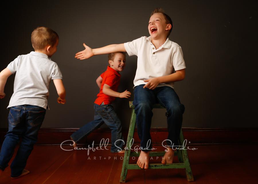 Portrait of children on grey background by child photographers at Campbell Salgado Studio in Portland, Oregon.