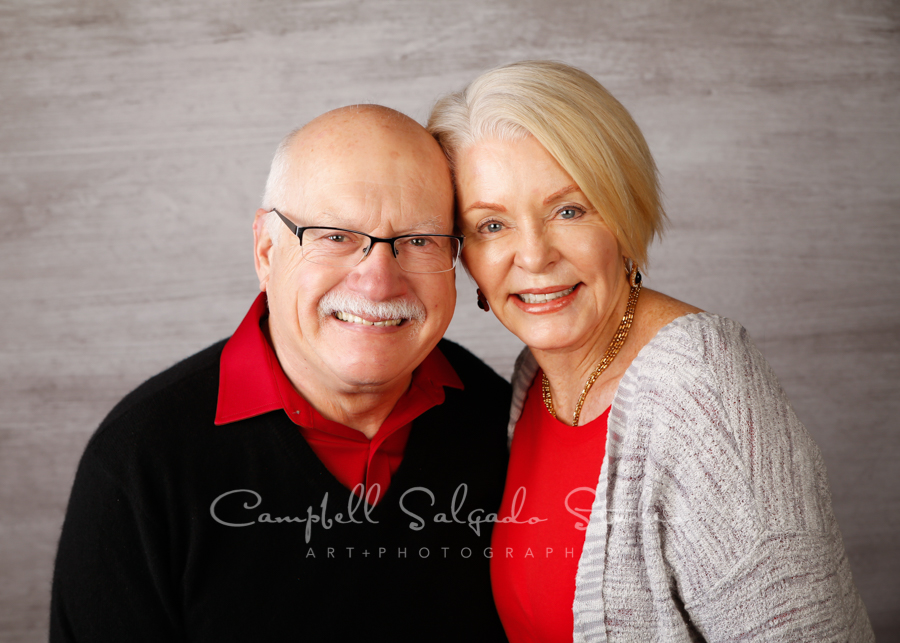 Portrait of couple on graphite background by couple's photographers at Campbell Salgado Studio in Portland, Oregon.