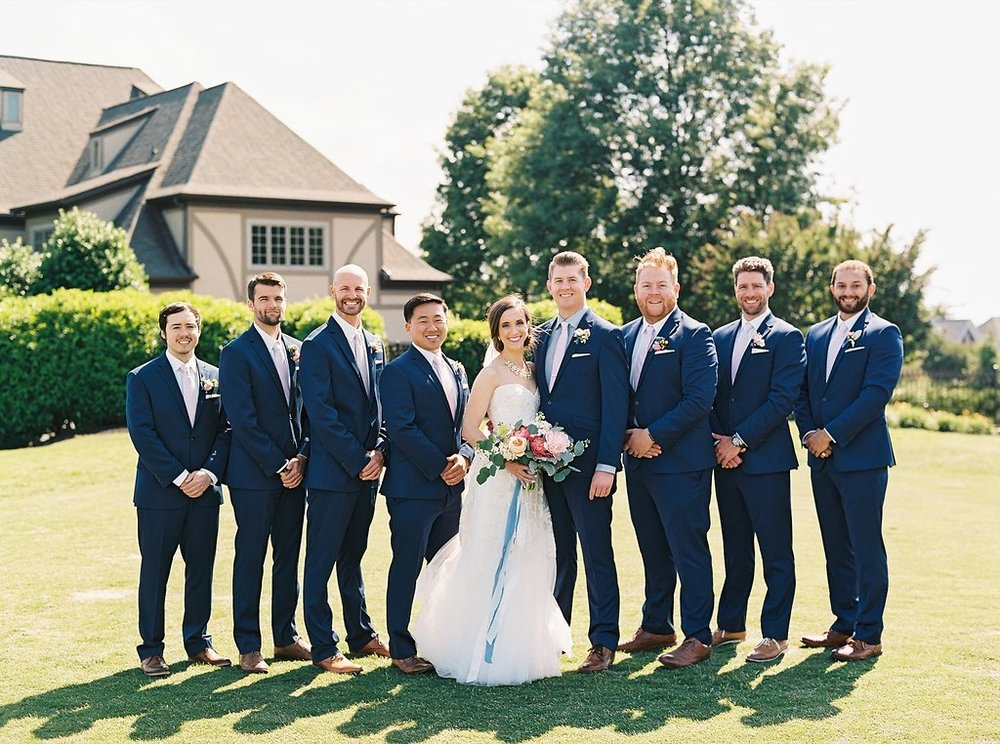 Bride in Reem Acra Gown and Navy Groomsmen with Blush Ties and Groom with Navy Gingham Shirt and Patterned Pocket Square | Blush and Navy Wedding with Fuchsia, French Blue and Gold Accents | Simply Jessica Marie's Southern Wedding at Gettysvue Golf Course and Country Club in Knoxville Tennessee | Photo by Perry Vaile Photography