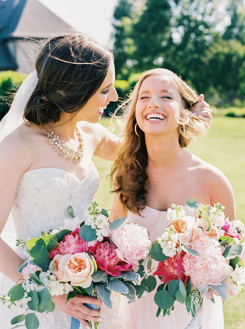 Sweet Bride and Maid of Honor Windblown Moment | Blush and Navy Wedding with Fuchsia, French Blue and Gold Accents | Simply Jessica Marie's Southern Wedding | Photo by Perry Vaile Photography