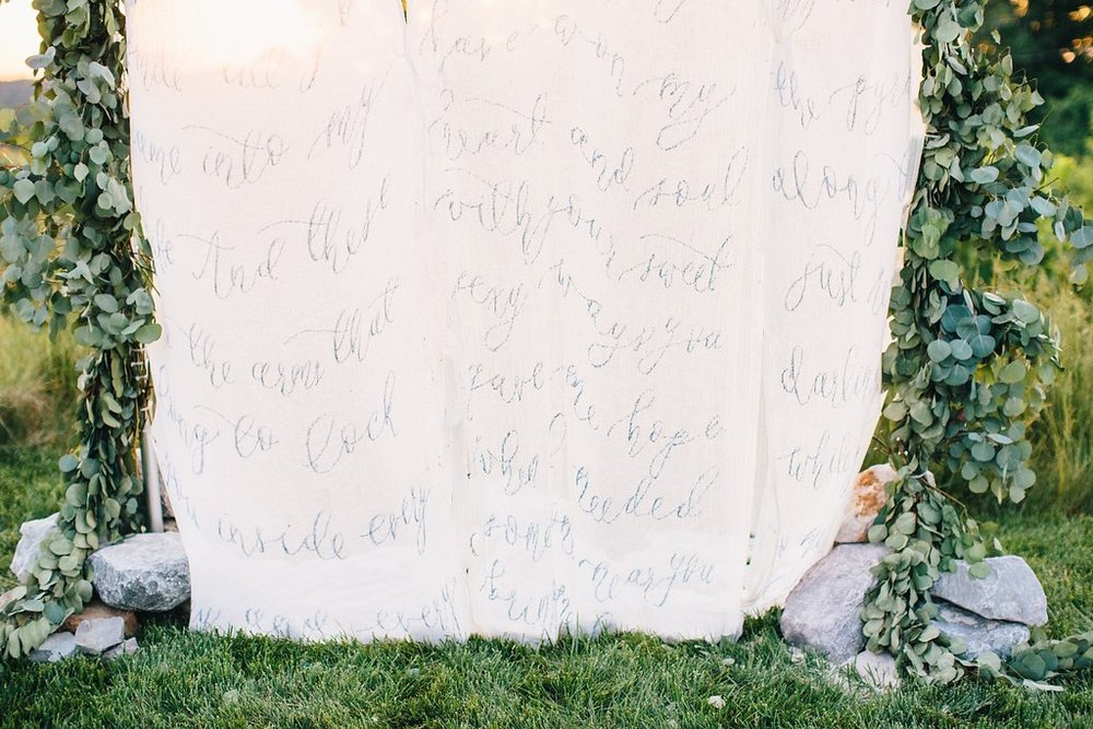 Navy Calligraphy Fabric Ceremony Backdrop Surrounded by Floral Arch | Outdoor Wedding Ceremony | Blush and Navy Wedding with Fuchsia, French Blue and Gold Accents | Simply Jessica Marie's Southern Wedding at Gettysvue Golf Course and Country Club in Knoxville Tennessee | Photo by Perry Vaile Photography