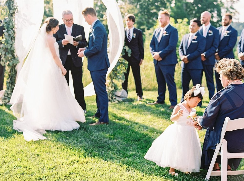 Flower Girl in Tulle Dress at an Outdoor Southern Wedding Ceremony | Blush and Navy Wedding with Fuchsia, French Blue and Gold Accents | Simply Jessica Marie's Southern Wedding | Photo by Perry Vaile Photography