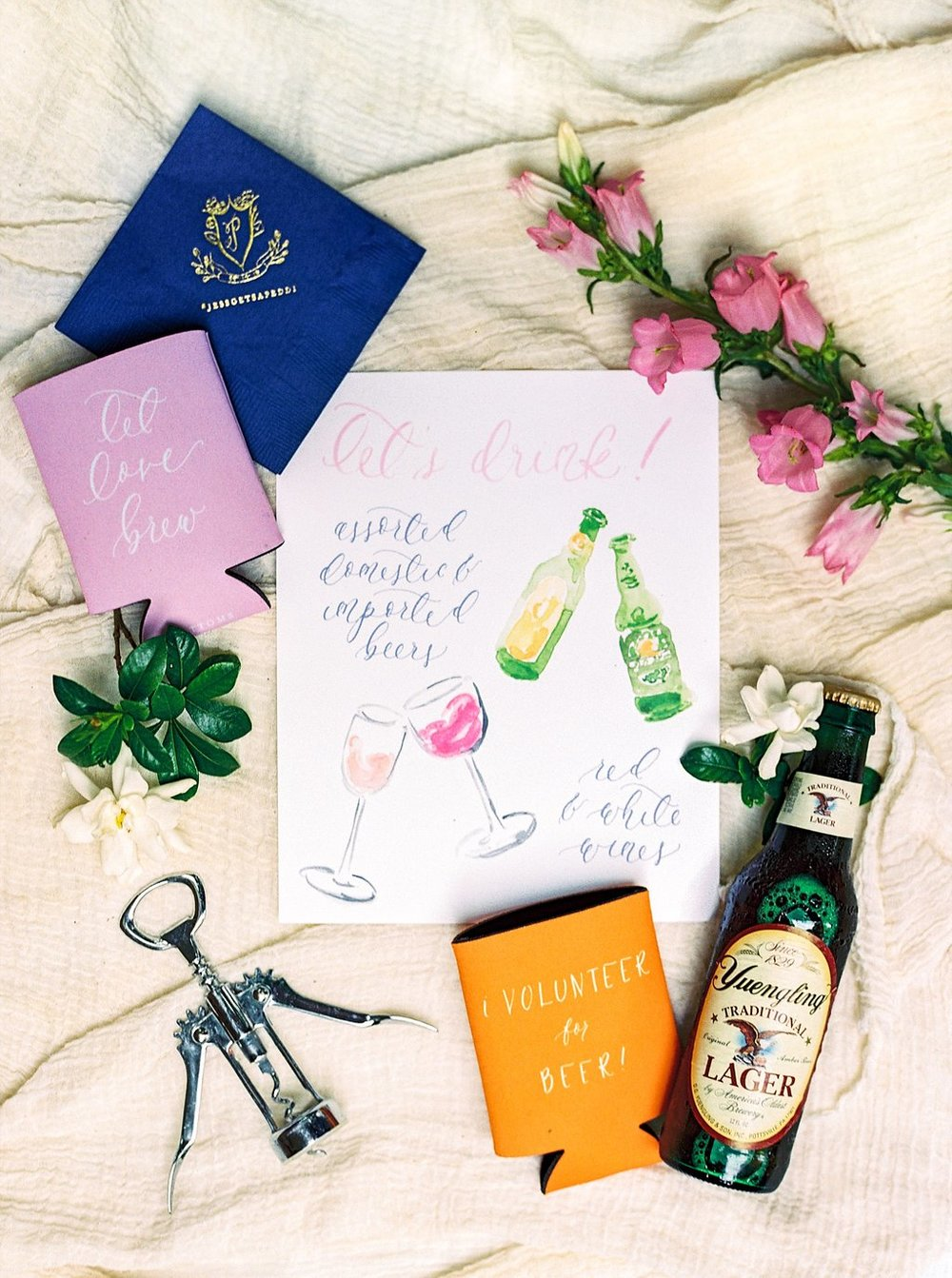 Custom Watercolor Bar Signage, Custom Calligraphy Wedding Koozies, and Custom Gold Foil Wedding Crest Cocktail Napkins | Blush and Navy Wedding with Fuchsia, French Blue and Gold Accents | Simply Jessica Marie's Southern Wedding at Gettysvue Golf Course and Country Club in Knoxville Tennessee | Photo by Perry Vaile Photography