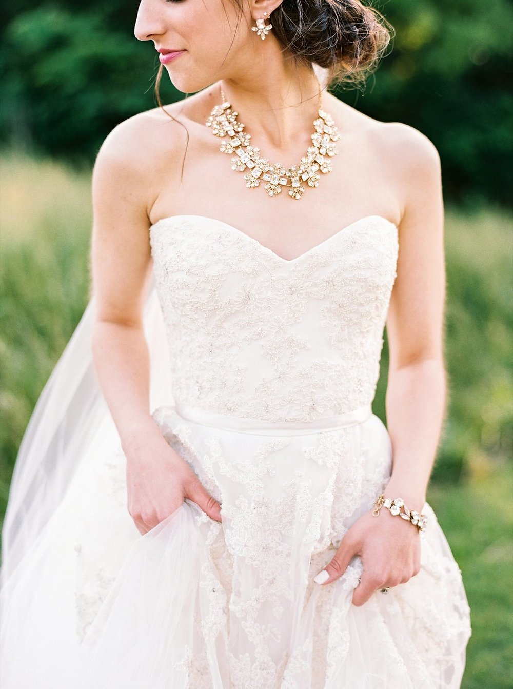 Southern Bride in Floral Lace and Tulle Reem Acra Gown with Kate Spade Crystal Arches Necklace and Low Messy Bun | Blush and Navy Wedding with Fuchsia, French Blue and Gold Accents | Simply Jessica Marie's Southern Wedding at Gettysvue Golf Course and Country Club in Knoxville Tennessee | Photo by Perry Vaile Photography