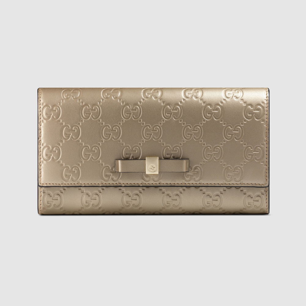 gucci-golden-beige-gucci-signature-bow-signature-continental-wallet-beige-product-0-838840425-normal.jpg