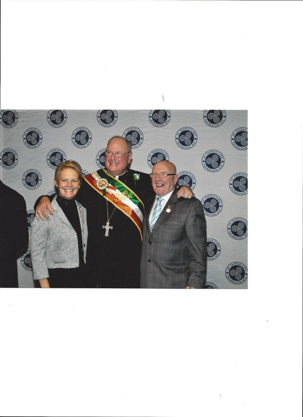 Treasa and Tommy with Grand Marshal.jpg