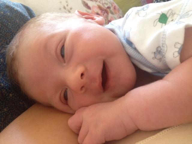 Baby Indigo smiling at 5 days old