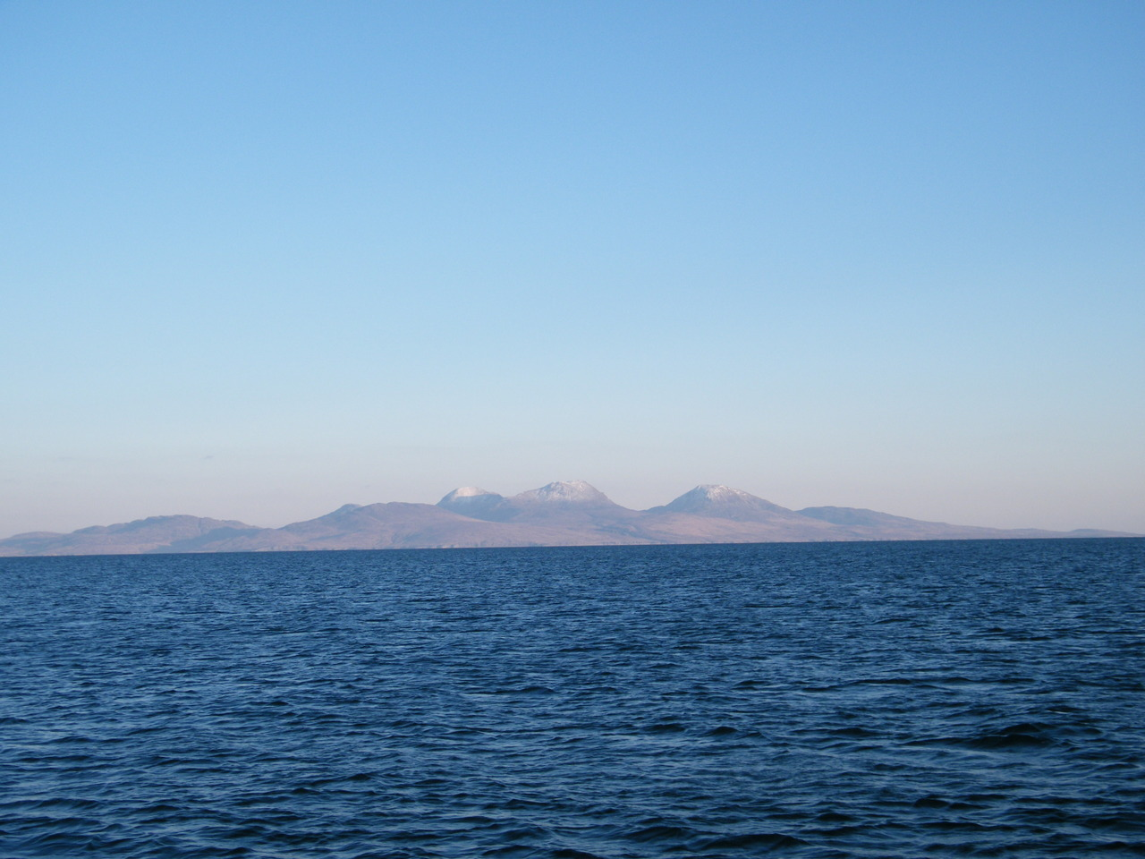 Snow on The Paps of Jura from Colonsay