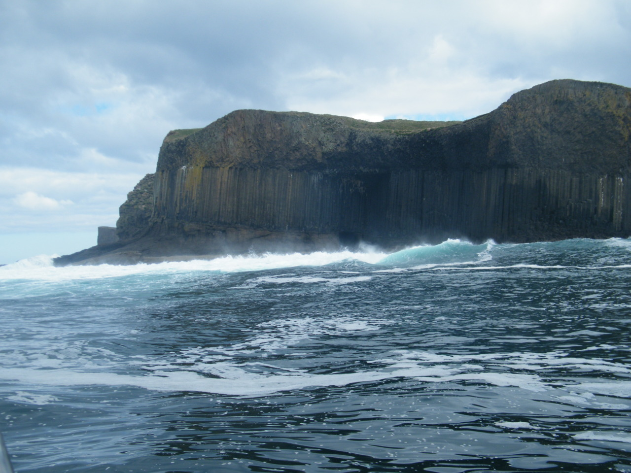 Swell breaking onto Staffa
