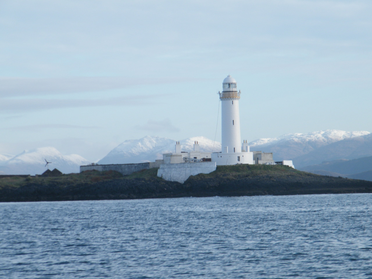 Lismore Lighthouse with snow capped mountains