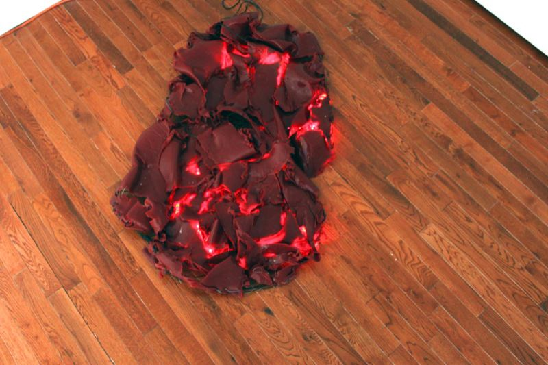 Lara Saget,  Heart  , 2013; AC motor, rubber, metal, audio clip of beating heart, and LED light; 20 x 40 x 6 inches