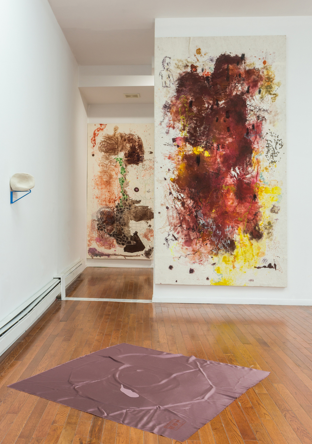 Wall (left): Genesis Belanger,  Hip-Jaw , 2015 Porcelain, steel, silicone, 9 x 8 x 10 inches  Floor: H. B. Peace,  Asunder Set #1 (Pink) , 2015 Tri-acetate, aluminum, straw, acrylic, 40 x 40 inches  Wall (right): Noah Furman,  Cut Me Open Watch Me Sprout Limbs and Dance,  2015 Dye, oil paint, highlighter, marker, wood stain, pastel, colored pencil on cotton bating on panel, 96 x 52 inches