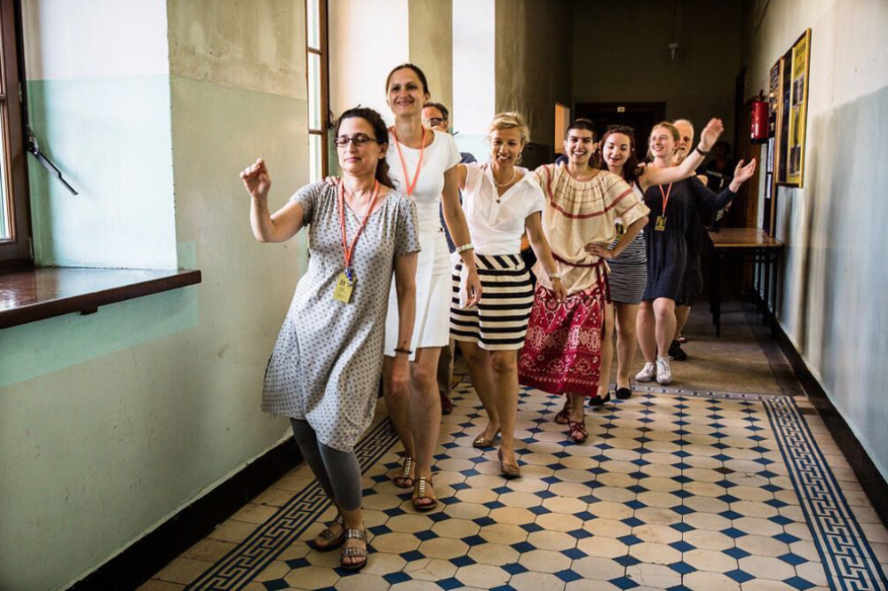 Overcome the Passive VI: the Jewish Culture Festival in Kraków. Klezmer music instructor Deborah Strauss takes her class into the hallway for an impromptu dance break.
