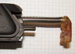The supplied buffer is a tight push fit onto the guide rod. Position it as shown.