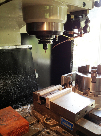 8045 mag undergoing modification on our CNC milling machine.
