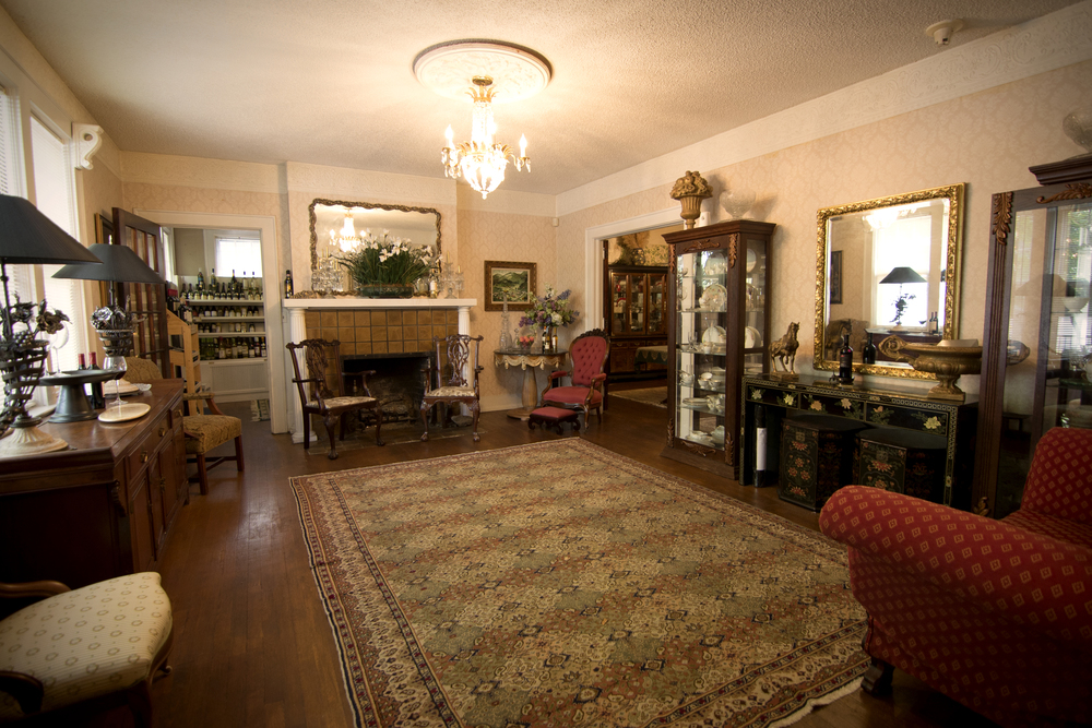 Our great room, which houses a wood-burning fireplace and antique fainting couch