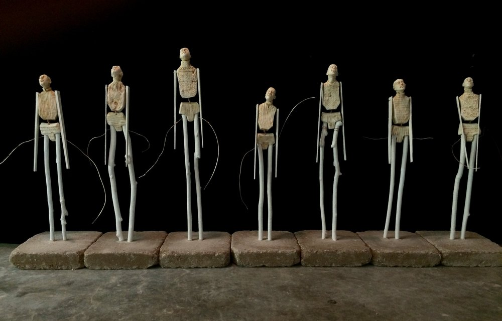 "The Stickleys, 16""-22""tall, fired clay and painted sticks"