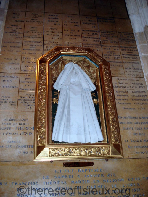 The baptismal garment of the Servant of God, Leonie Martin, handed down to her sister, St. Therese of the Child Jesus.  Notre-Dame Church, Alencon