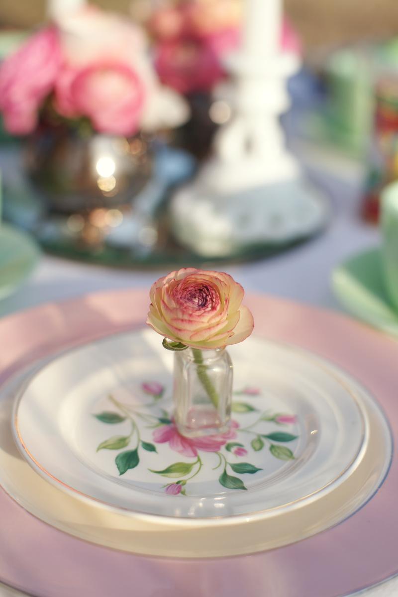 Rose bud in vase on mismatched vintage chine   Maine Wedding & Portrait Photographer