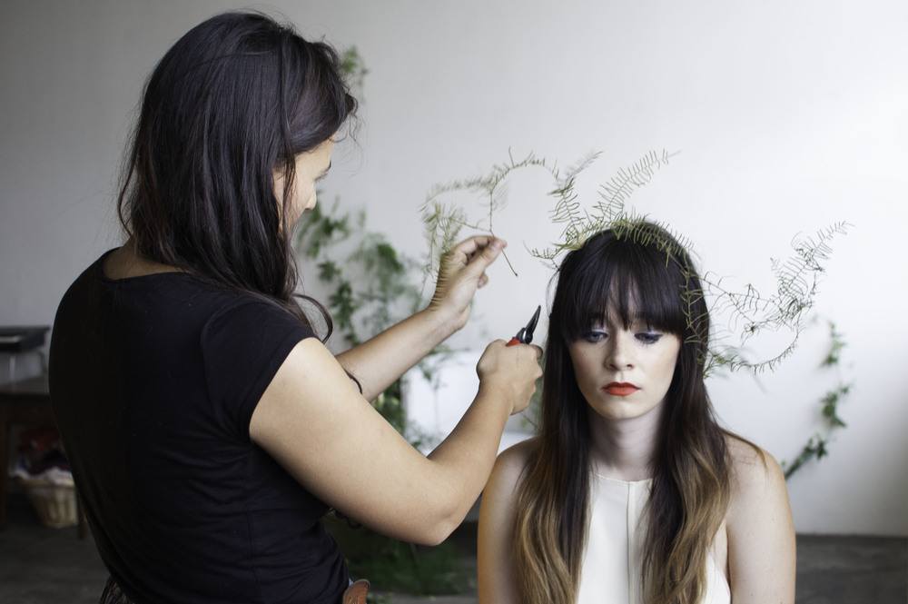 Brittany arranging a flower halo for our model, Rachel Marie