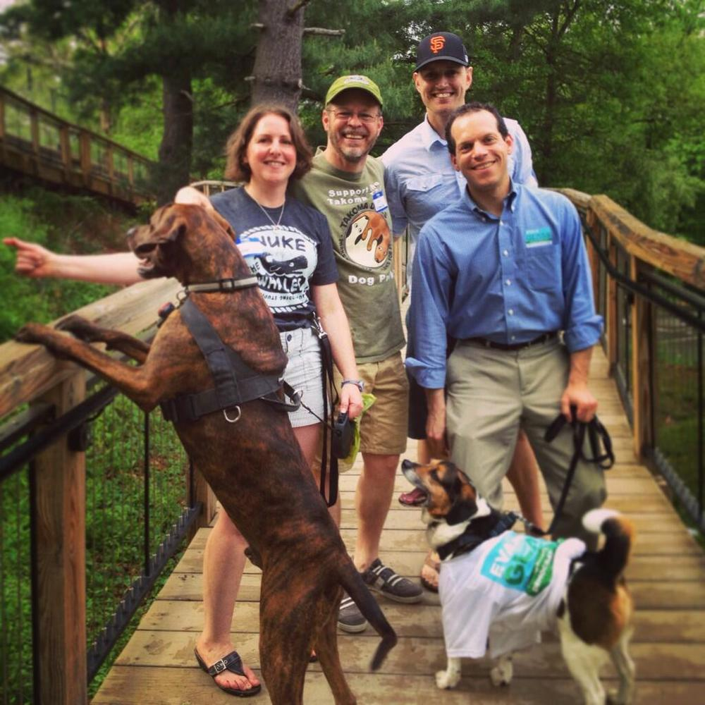 From left: Brody, TakomaDogs Board Member Nicole LeBoeuf, TakomaDogs Founder Joe Edgell, TakomaDogs Chief Designer Eric Saul, County Council Candidate Evan Glass, and Percy enjoy a day at the planned dog park.