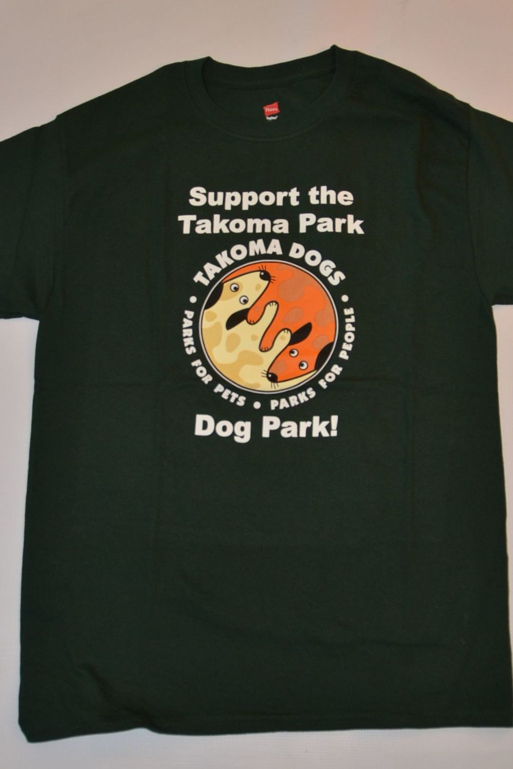 "Dark green Hanes 5.1 Tagless T-shirt.  100% cotton. Has the TakomaDogs ""Parks for Pets. Parks for People"" slogan on back."