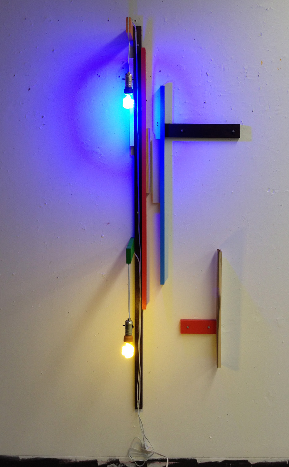 Untitled (Construction of blue, yellow, and poplar)    enamel on poplar with CFL bulbs and nails 2013