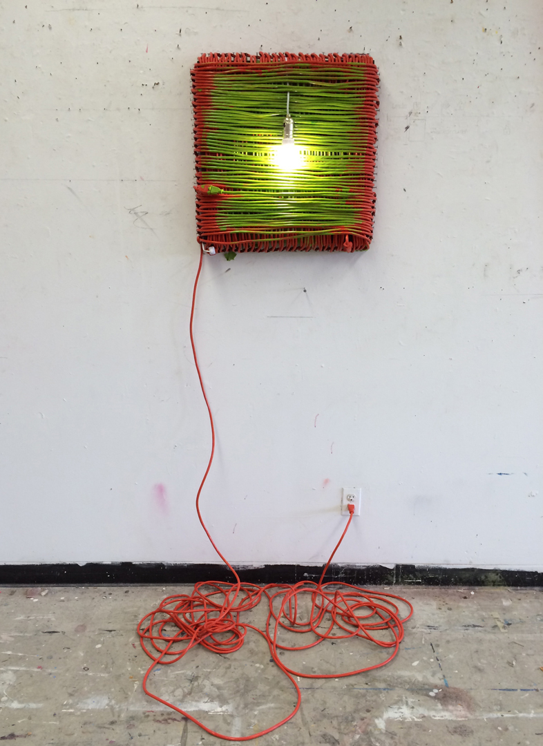 Untitled (Construction of orange, green, and white)   enamel and extension cord on wood panel with nails and bright white CFL bulb 2013