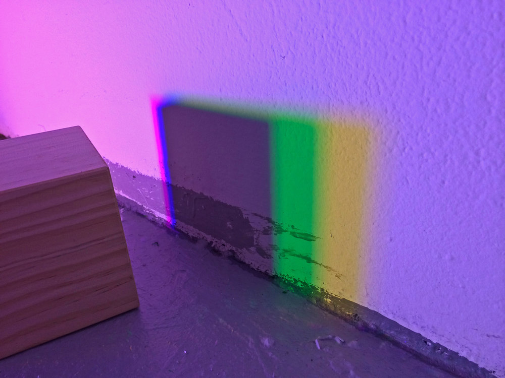 Bending, blending, breaking (light)  light, wooden cube, shadows and refractions