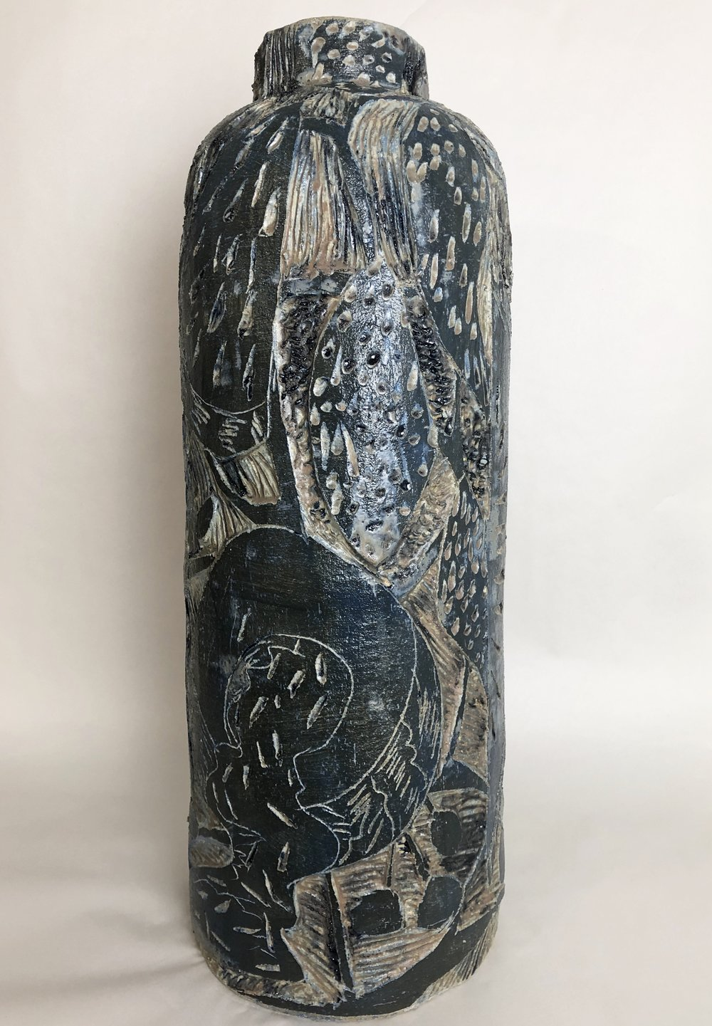 "Stoneware and Glaze, 10.5""x29""."