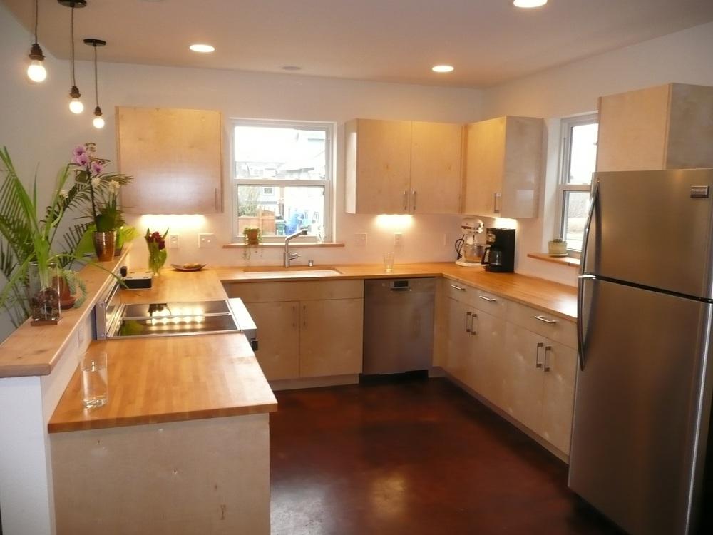 Clean Kitchen Countertops Refrigerator Cabinets Sink Hardwood Floor Window  Organized