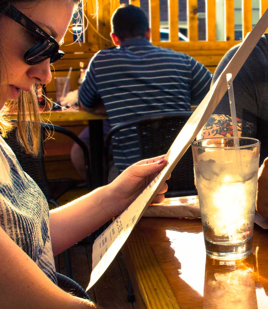 My lovely friend Melissa studying the menu on the patio.