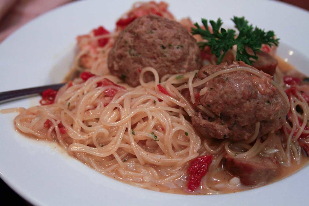Pasta Sovranita with Meatballs - House Specialty with Sausage, Garlic, Sun-dried Tomatoes in a Marsala Wine Sauce