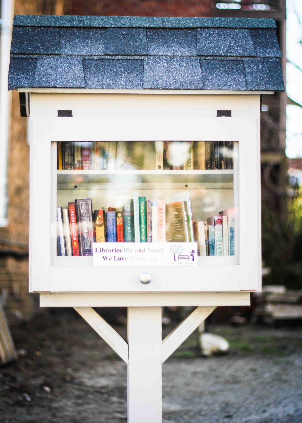 The Little Free Library in front of Black Hand Coffee in the Museum District.