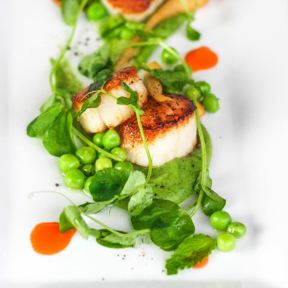 Sea scallops with peas and carrots are on Saison's spring menu