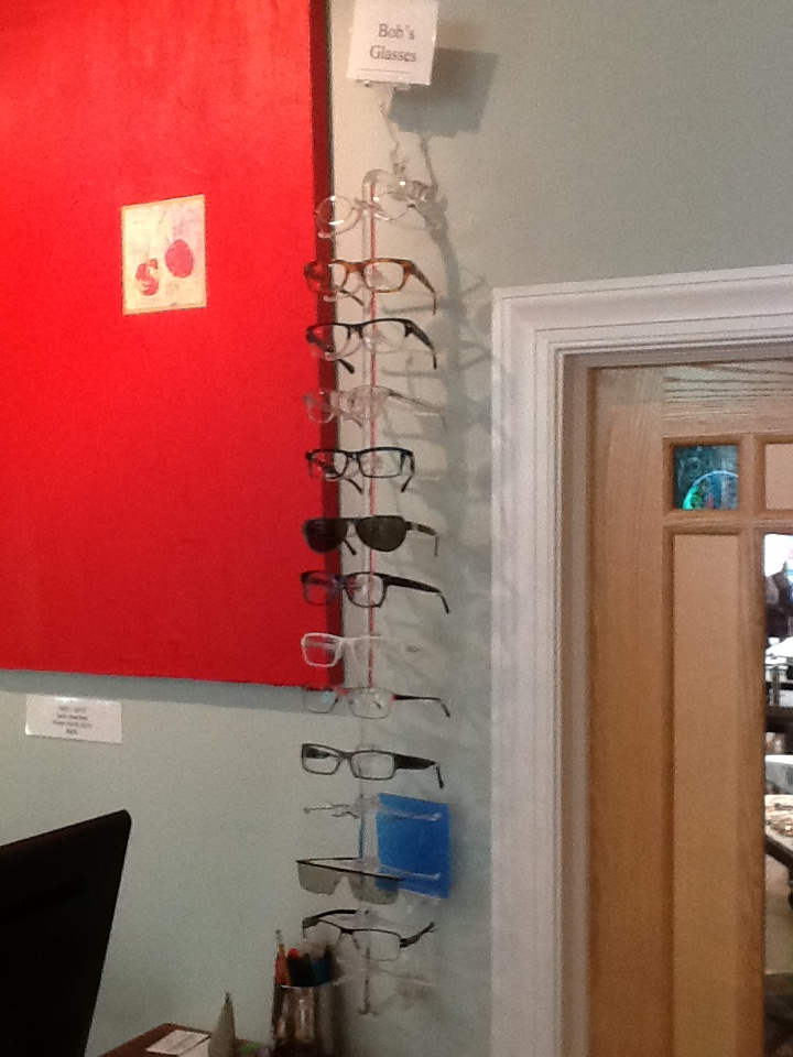 """About two years ago, I decided to take all my glasses out of cases and put them on display rods at home and in the store. No more out of sight, out of mind. Well it has been fun seeing peoples different reactions. """"Oh, are these your favorites""""? """"Who's Bob?"""" """"Wow! These lenses are warped or something""""."""