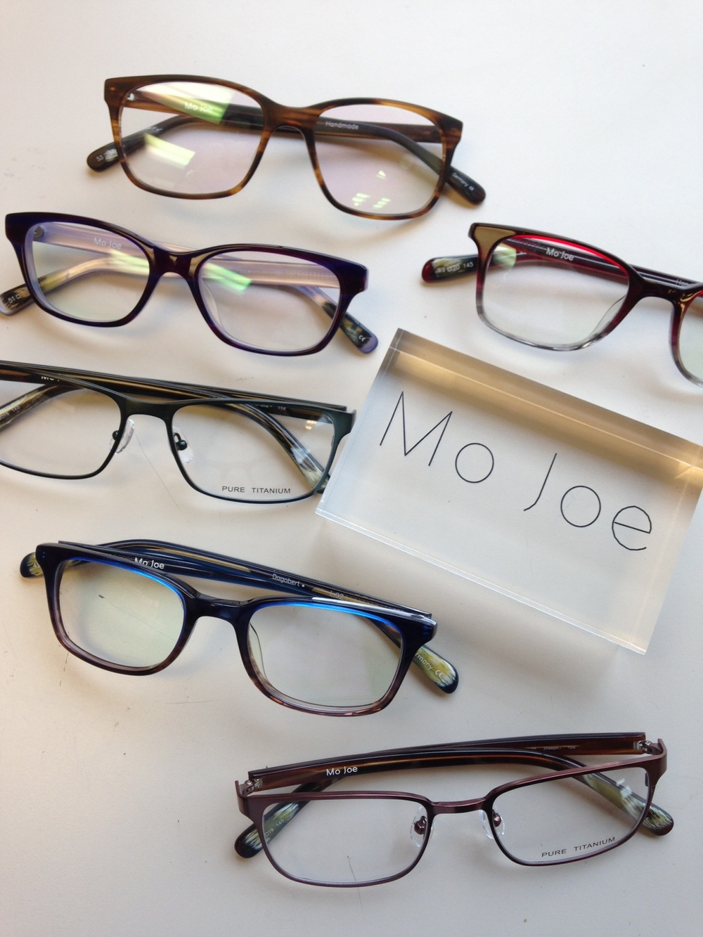 We just brought in a collection of private label frames from Sho Eyeworks.  The main reason we chose to bring in this collection?.....We needed another option at an under $200 price point that was high quality, on trend but also classic with universal appeal, and that our customers couldn't shop around.  We gave them our own personalized name, MoJoe. One of my fellow opticians, Krystal came up with the name idea as something fun and memorable, but also as a nod to our owner, Dr. Joe, who celebrates 40 years of ownership this year.