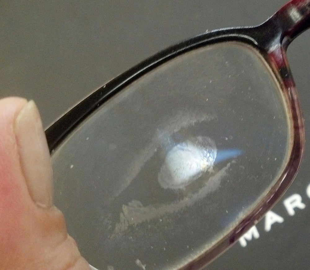 As she handed me her glasses a confession was flowing before we reached our chairs. While walking through a building she face planted into a glass door leaving an authentic blemish in the anti reflective coating on her lens. Ouch! I listened intently while I assessed what needed to be done. In hopes of consoling her I shared my own humbling experience. We laughed and she allowed me to share her tale. (Am I alone when i think her smudge is cool?)