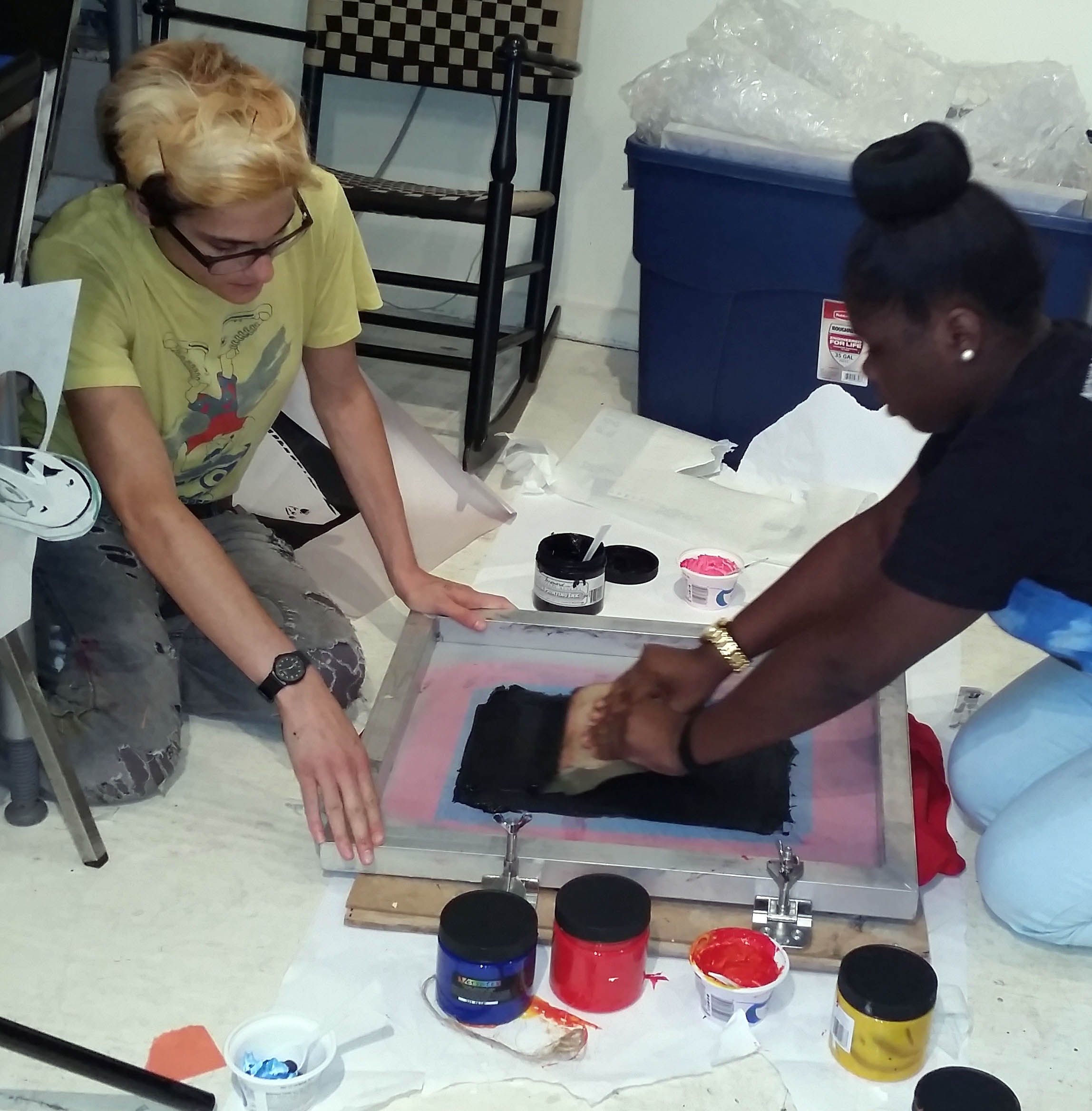 RHAP visual art tutor teaching screen printing to visual art student.
