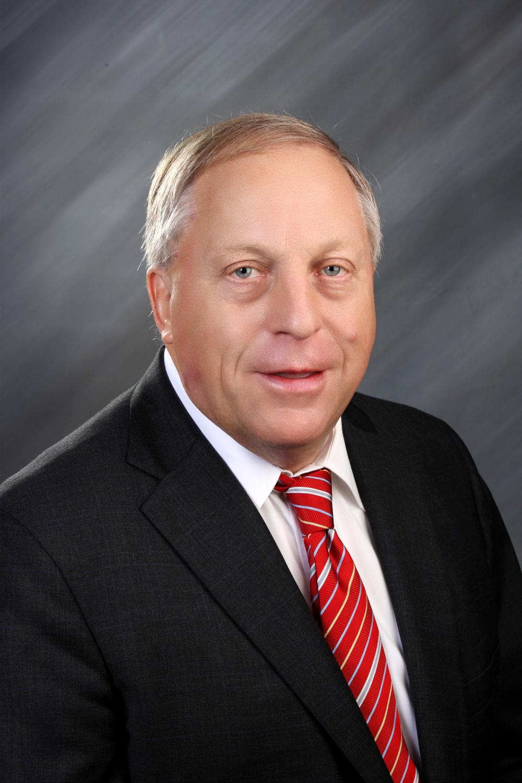 DIRECTOR JAMES A. McSHANE CEO McSHANE CONSTRUCTION COMPANY