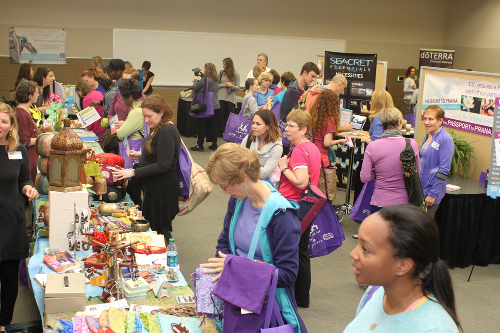 The exhibitors room featuring yoga studios, health providers, clothing, food & beverage