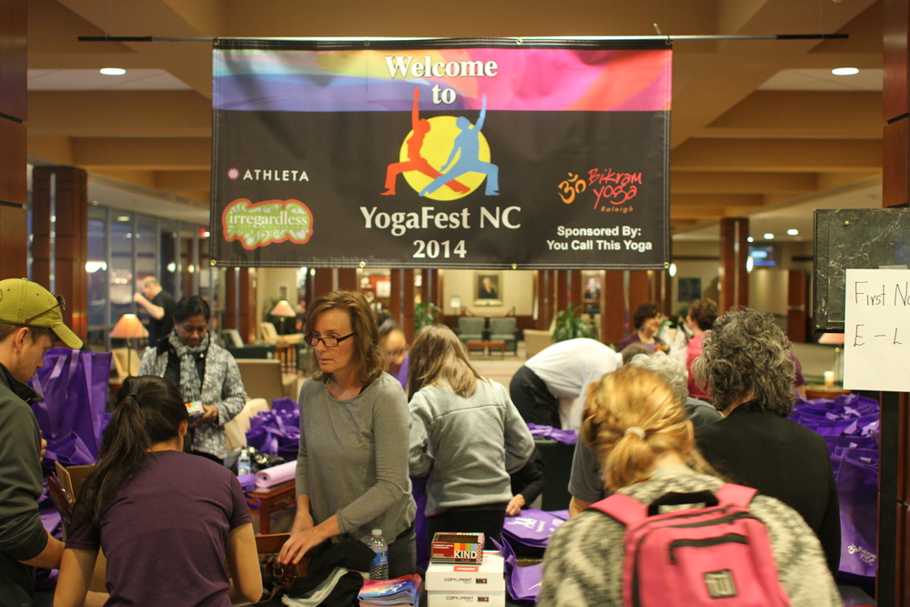 Setting up for registration at YogaFest NC 2014