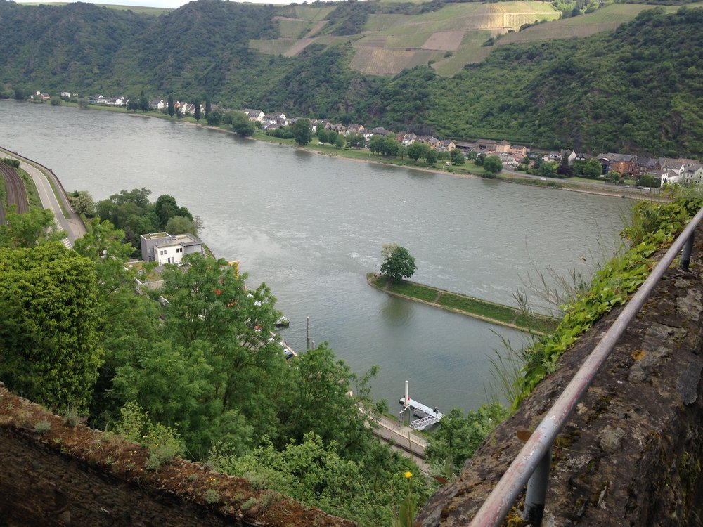 "This is a view of St. Goar (properly said with two syllables ""Go-Ar"").  Janice and I were with a smaller part of our group who walked up, along a nice trail through the woods to the right, to get to Castle Rhinefelz.  It was a beautiful walk, though sometimes Janice had to pull me along."