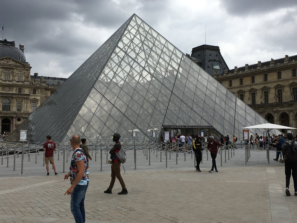 A view of one side of the Louvre from the glass pyramid.