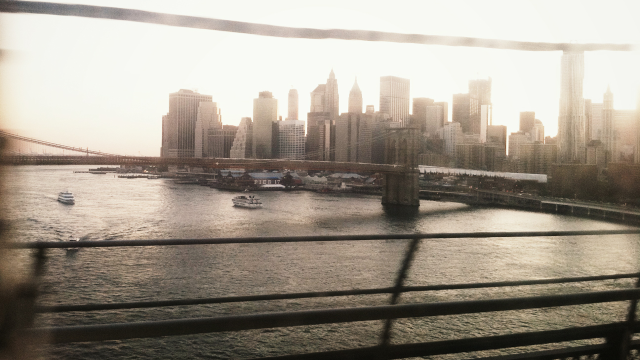 {crossing the Manhattan Bridge}