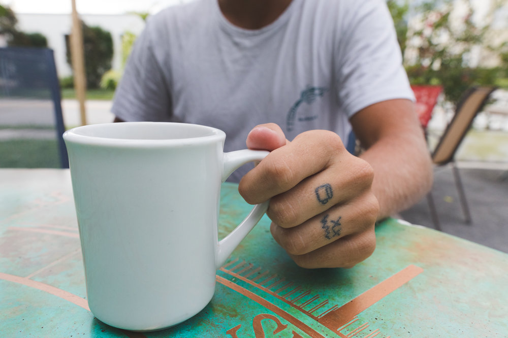 Chaun Chaun has been experimenting with tattooing himself. First Tats get dedicated to a cup of Coffee. He's a true surfer.