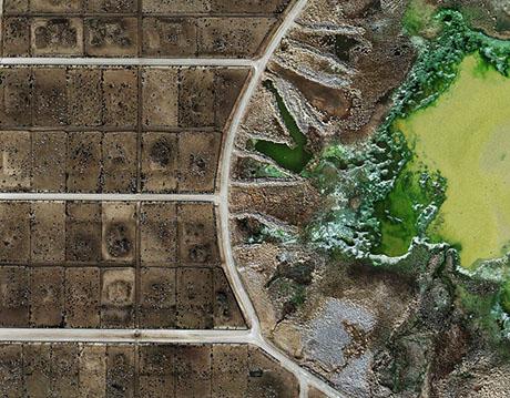 """Feedlot Manure Lagoon in Tascosa Feedlot, Texas"""" (2013), Credit: Mishka Henner"""