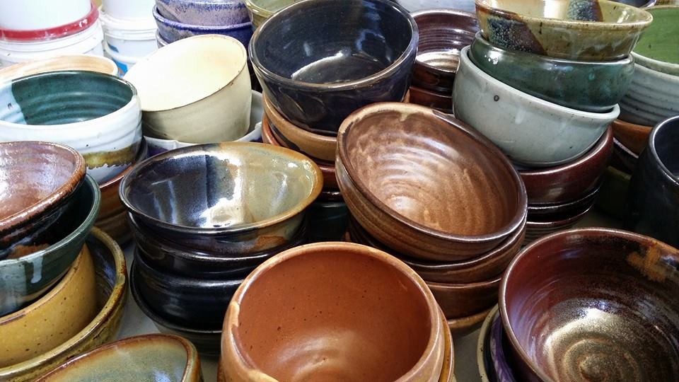 Finished bowls awaiting purchase, all for a good cause. Art + food + good cause = happy seniors & full tummies! Credit: Empty Bowl Hawaii.